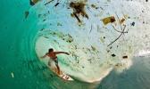 surfing in a plastic ocean